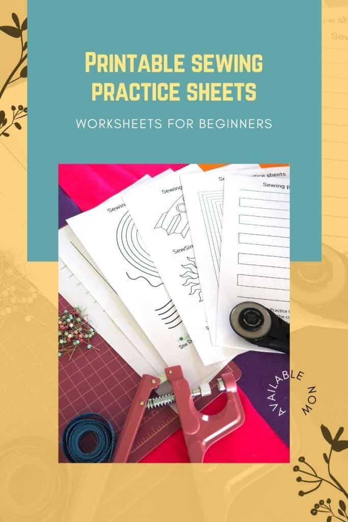 Printable sewing practice sheets on a cutting board with sewing supplies