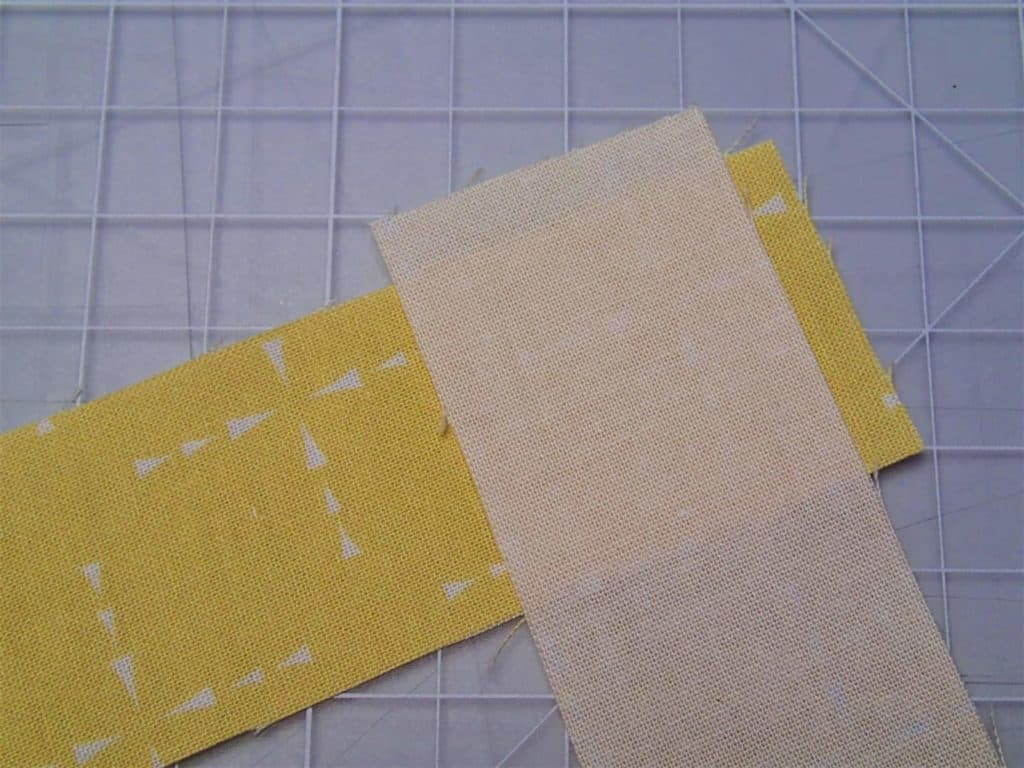 Binding pieces placed right sides together at right angles