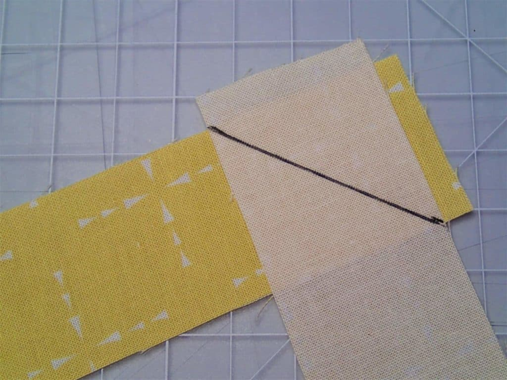 Binding pieces right sides together at right angles with a line drawn diagonally
