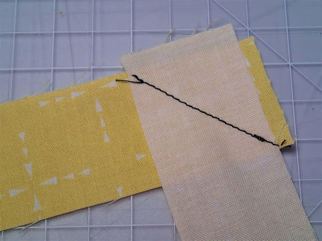 Two pieces of binding sewn with a diagonal seam