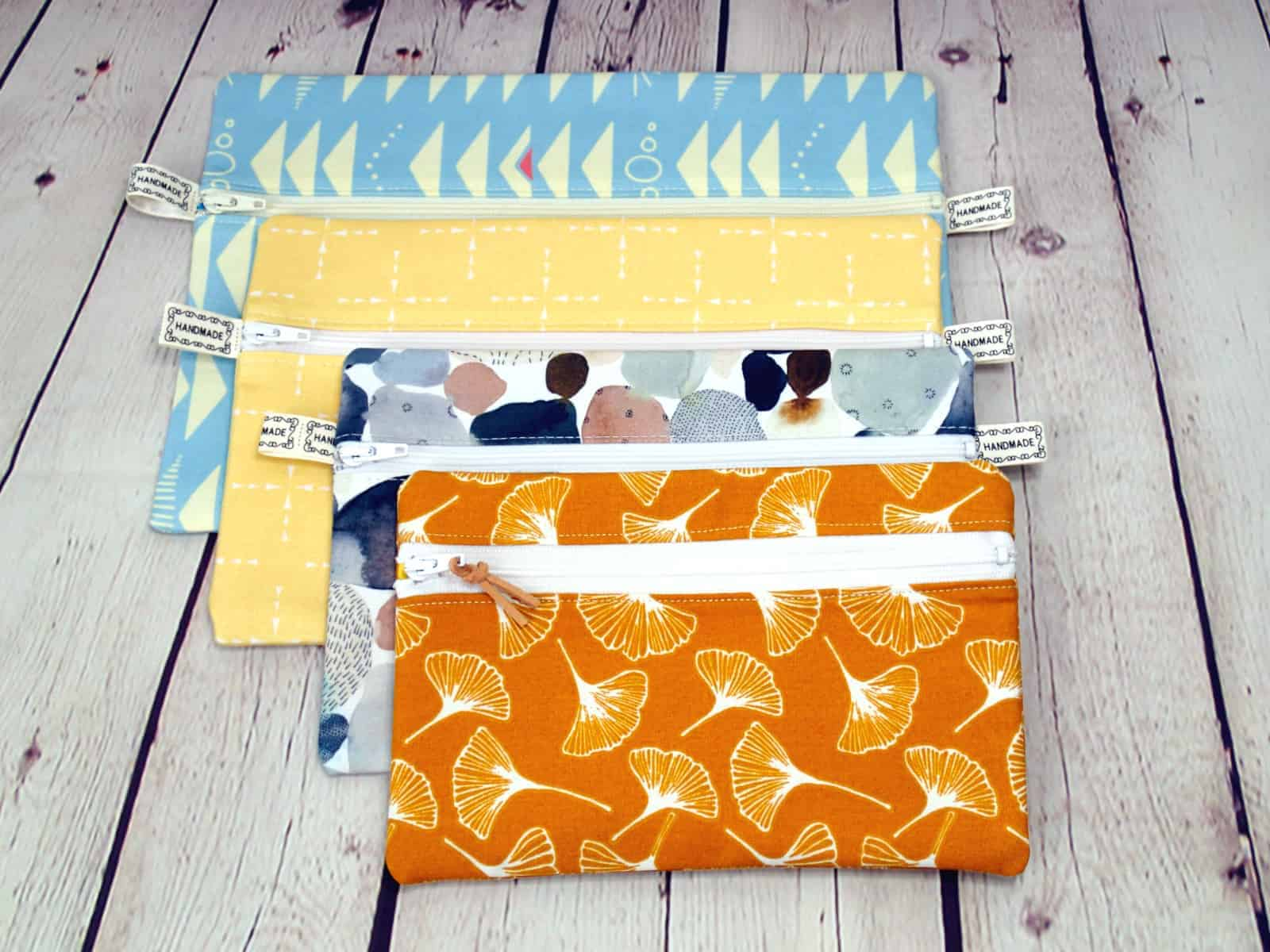 4 easy to sew zipper pouches, image comparing the size of the finished zipper bags from one sewing pattern